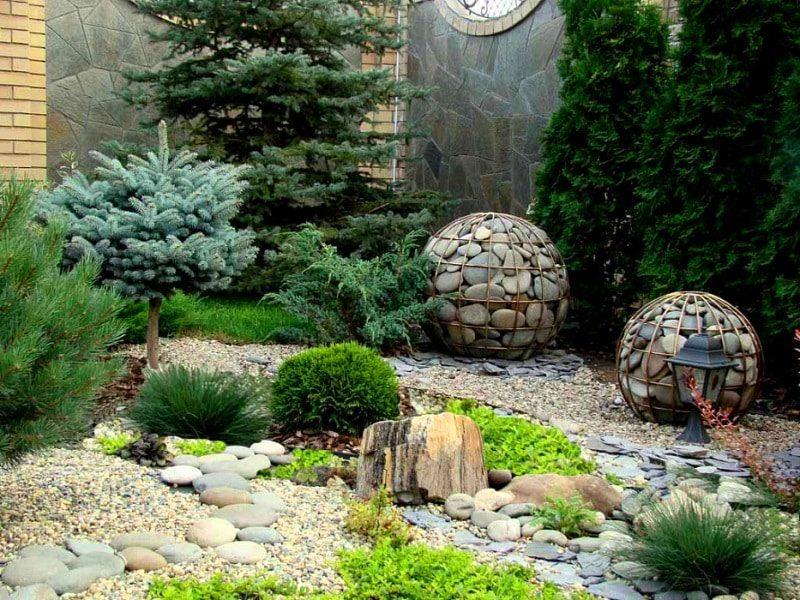 декоративная галька в саду в Москве - перваядачная.рф